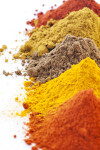 Spice mix with different exotically spices as closeup on white background