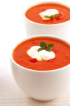 Roasted tomato and herb soup, with capsicum and yoghurt.