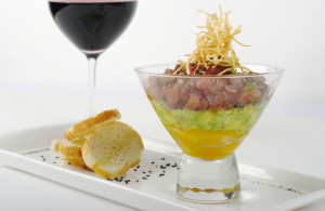 Starter out of Raw Tunafish, Avocado and Mango in Glass